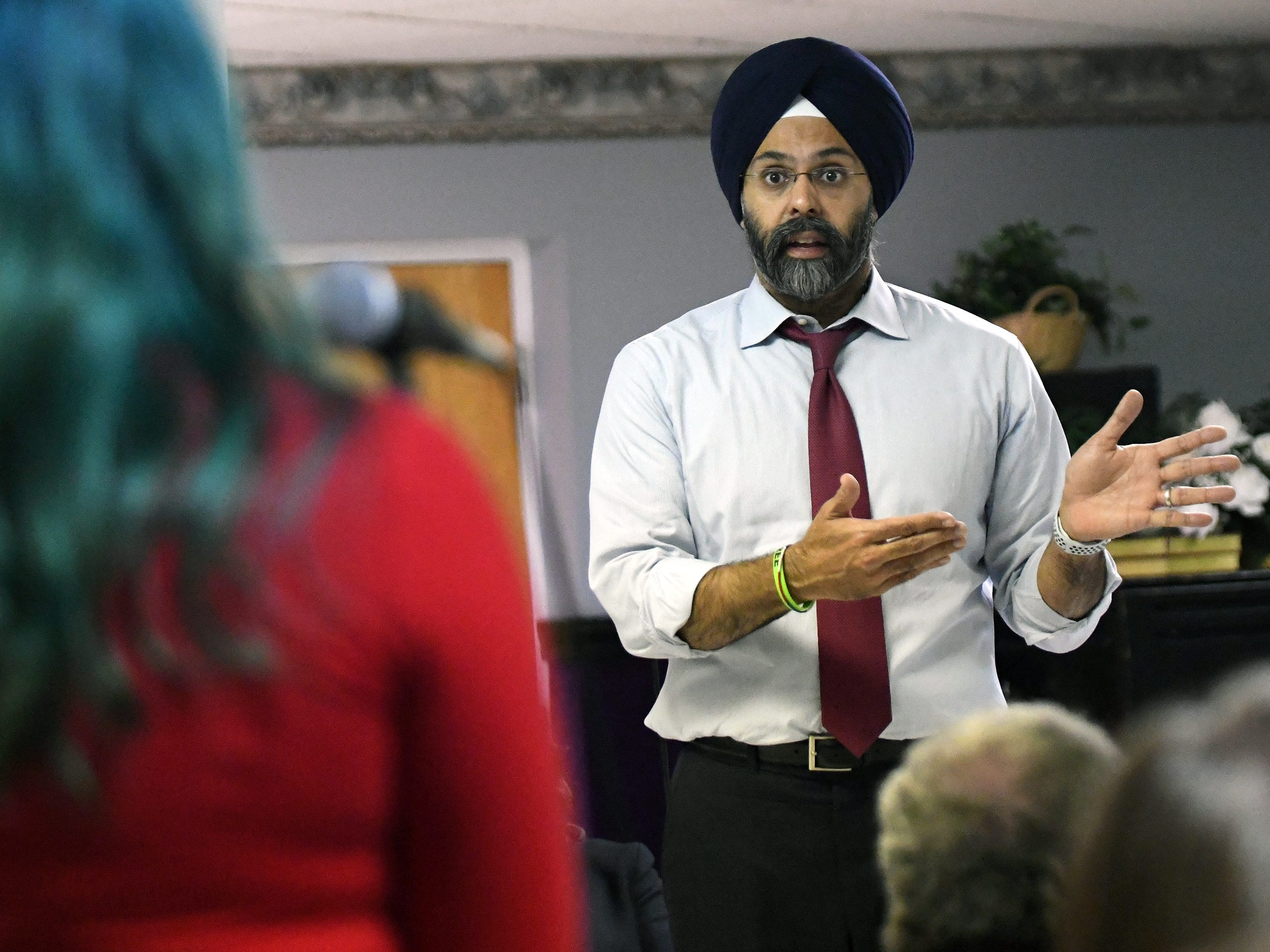 "N.J. Attorney General Gurbir S. Grewal answers questions from the crowd regarding ""use of force"" reporting at a community ""listening session"" at Union Baptist Temple in Bridgeton on Wednesday, Jan. 23, 2019."