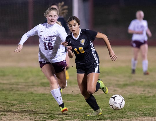 Golden West's Izabel Pelayo, right, and Mt. Whitney's Kyanna Orozco battle for control in a girls soccer game on Wednesday, January 23, 2019.