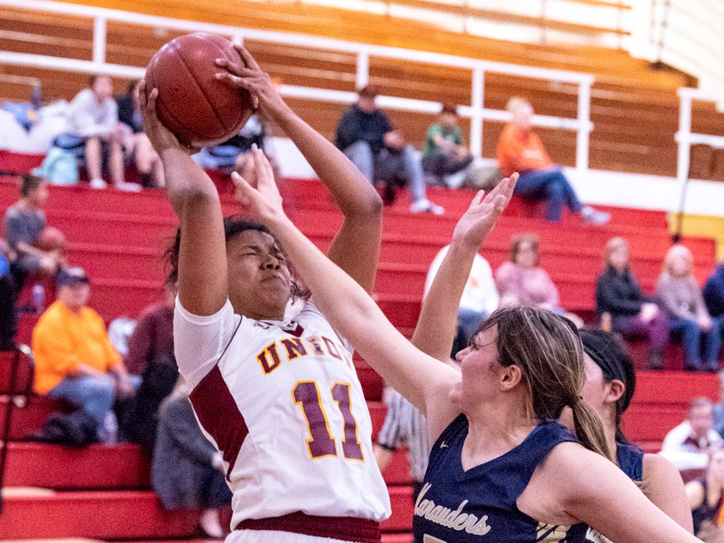 Tulare UnionÕs Kiara Brown makes a shot to put her over 2,000 career points in a girls basketball game against Monache on Tuesday, January 22, 2019.