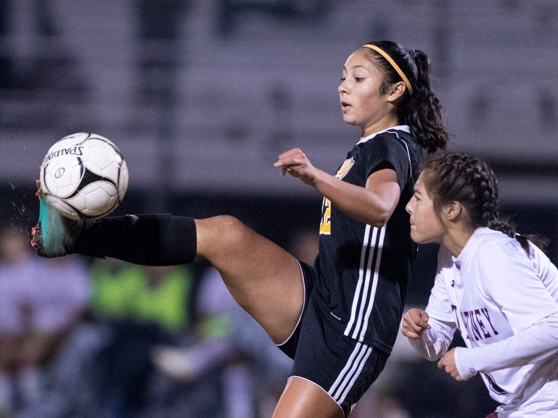 Golden West's Serina Oceguera, left, and Mt. Whitney's Taylor Bocanegra battle in a girls soccer game on Wednesday, January 23, 2019.