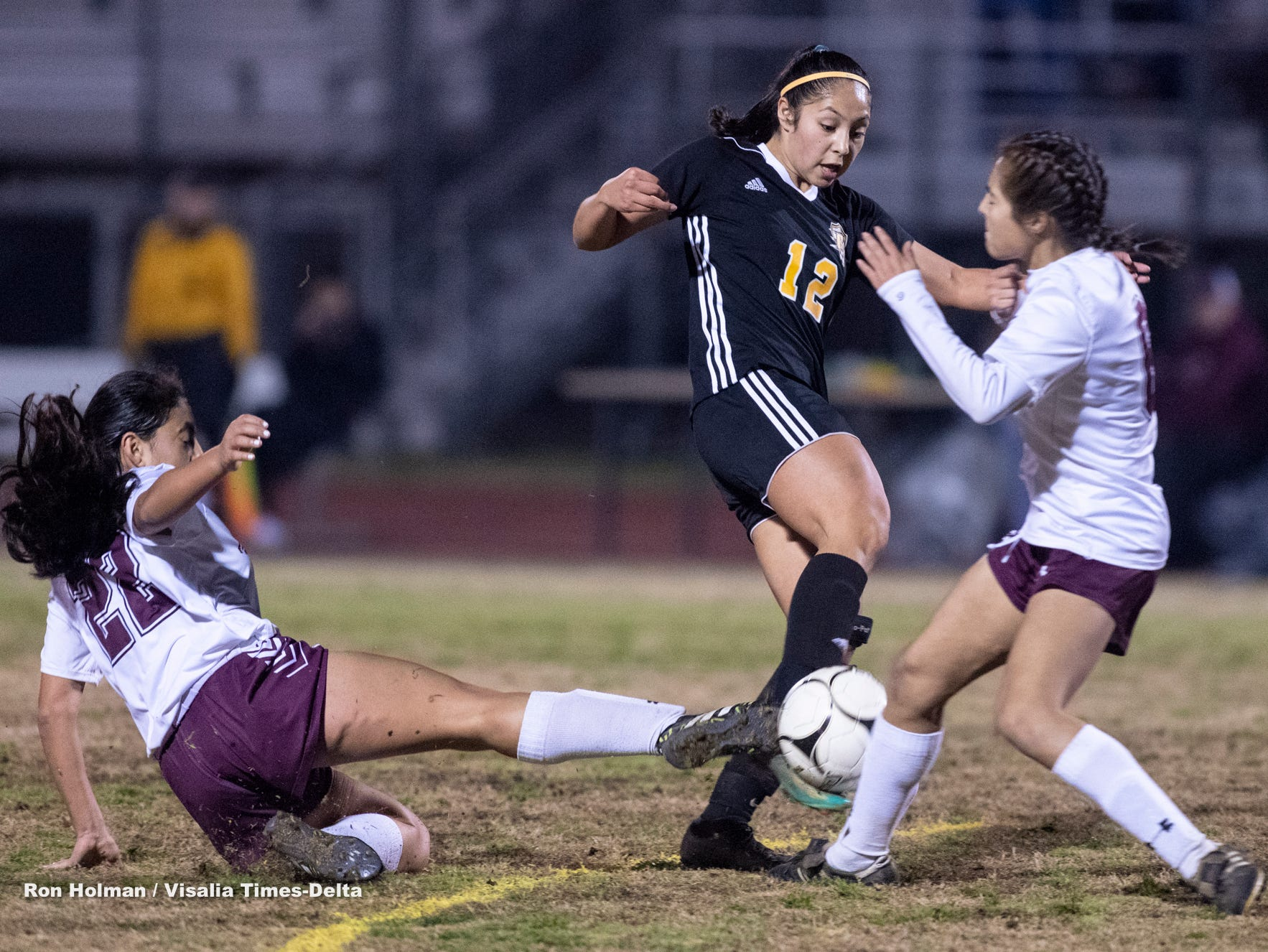 Mt. Whitney's Jocelyn Garcia, left, and Taylor Bocanegra pressure Golden West's Serina Oceguera in a girls soccer game on Wednesday, January 23, 2019.