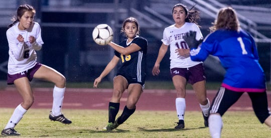 Golden West's Izabel Pelayo (15) takes a shot on goal against Mt. Whitney in a girls soccer game on Wednesday, January 23, 2019.