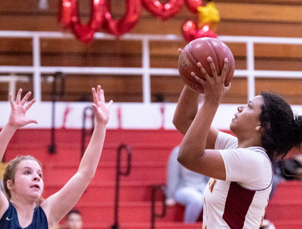 Tulare UnionÕs Kiara Brown shoots against Monache's Kailyn Castle in a girls basketball game on Tuesday, January 22, 2019. She passed the 2,000 point mark in her career during the first quarter.