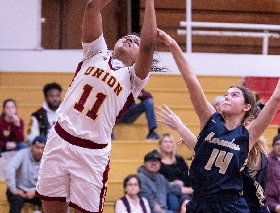 Tulare UnionÕs Kiara Brown shoots against Monache's Danielle Garcia in a girls basketball game on Tuesday, January 22, 2019. She passed the 2,000 point mark in her career during the first quarter.
