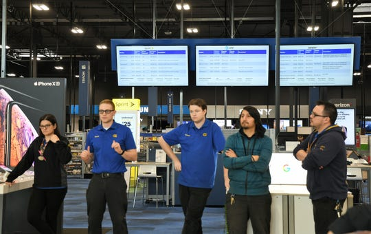 Visalia Best Buy employees hold a staff meeting minutes before the new store opens to the public on Jan. 24, 2019.