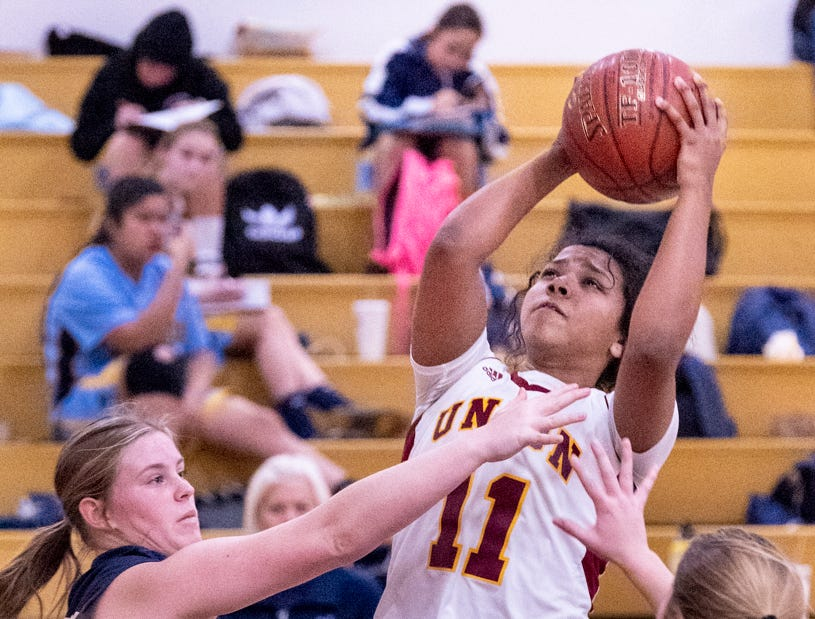 Tulare UnionÕs Kiara Brown shoots against Monache in a girls basketball game on Tuesday, January 22, 2019. She passed the 2,000 point mark in her career during the first quarter.