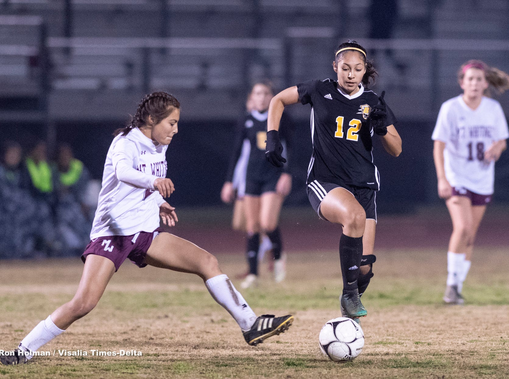 Mt. Whitney's Taylor Bocanegra, left, pressures Golden West's Serina Oceguera in a girls soccer game on Wednesday, January 23, 2019.