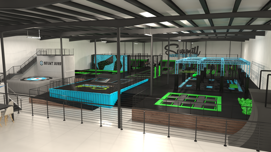 "A rendering of the planned inside of Sawmill Adventure Park. Children will be able to jump from the top of the ""Stunt Jump,"" left, onto a soft target at the bottom. There is a smaller trampoline grid for younger children, right."