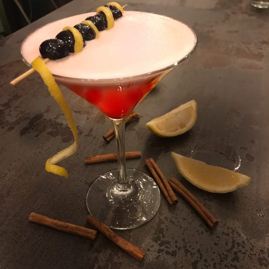 """The """"I'm Not Bitter"""" cocktail at DVine Pie in Piermont. The specialty cocktail is a mixture of gin, raspberry cinnamon syrup, lemon and filthy cherries."""