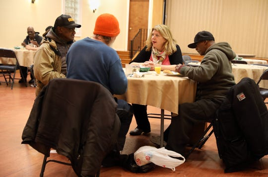 Kim Cross, executive director of the Nyack Center and the co-coordinator of the point-in-time count at Grace Episcopal Church, speaks with guests during breakfast at Grace's Kitchen Jan. 24, 2019. The point-in-time count is a nationwide count of homeless people required by the U.S. Department of Housing and Urban Development (HUD) which sets funding levels based on the count.