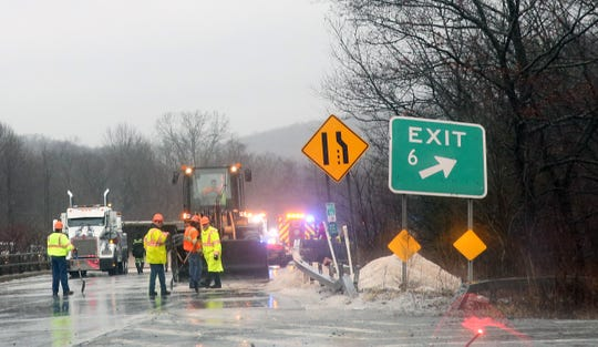 Highways workers clean up the sand that spilled onto the highway after a truck carrying sand rolled over on northbound Interstate 684 at exit 6 in Katonah on Jan. 24, 2019.