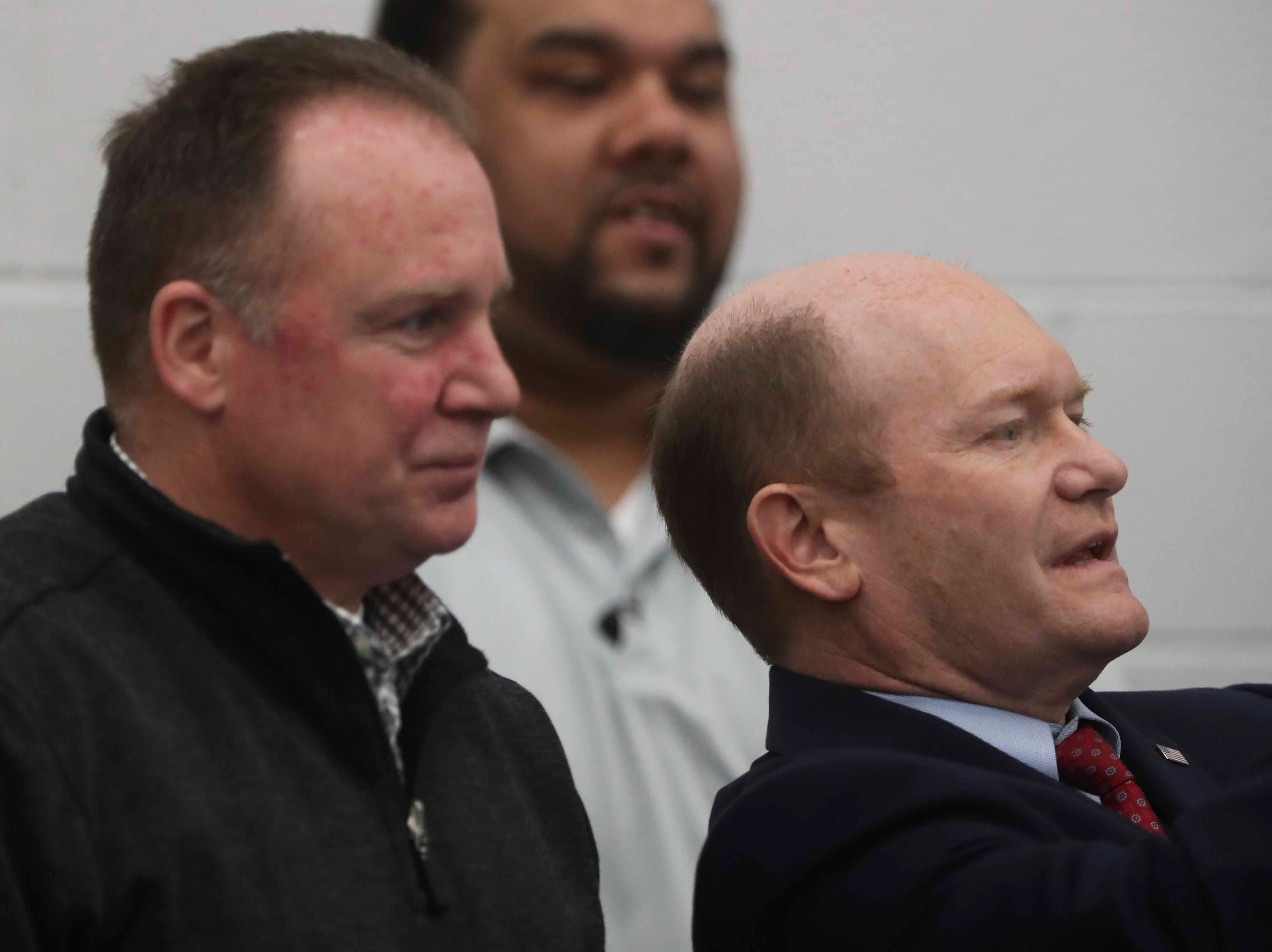 Wilmington police chief Robert Tracy (left) chats with US Senator Chris Coons courtside as Coons leans back to snap a photo as the Delaware Blue Coats of the NBA G-League open the 76ers Field House in Wilmington Wednesday. The event was the place to be for Wilmington, county and state officials and movers-and-shakers, with dozens of VIPs in the crowd from city government to the partnering private companies.