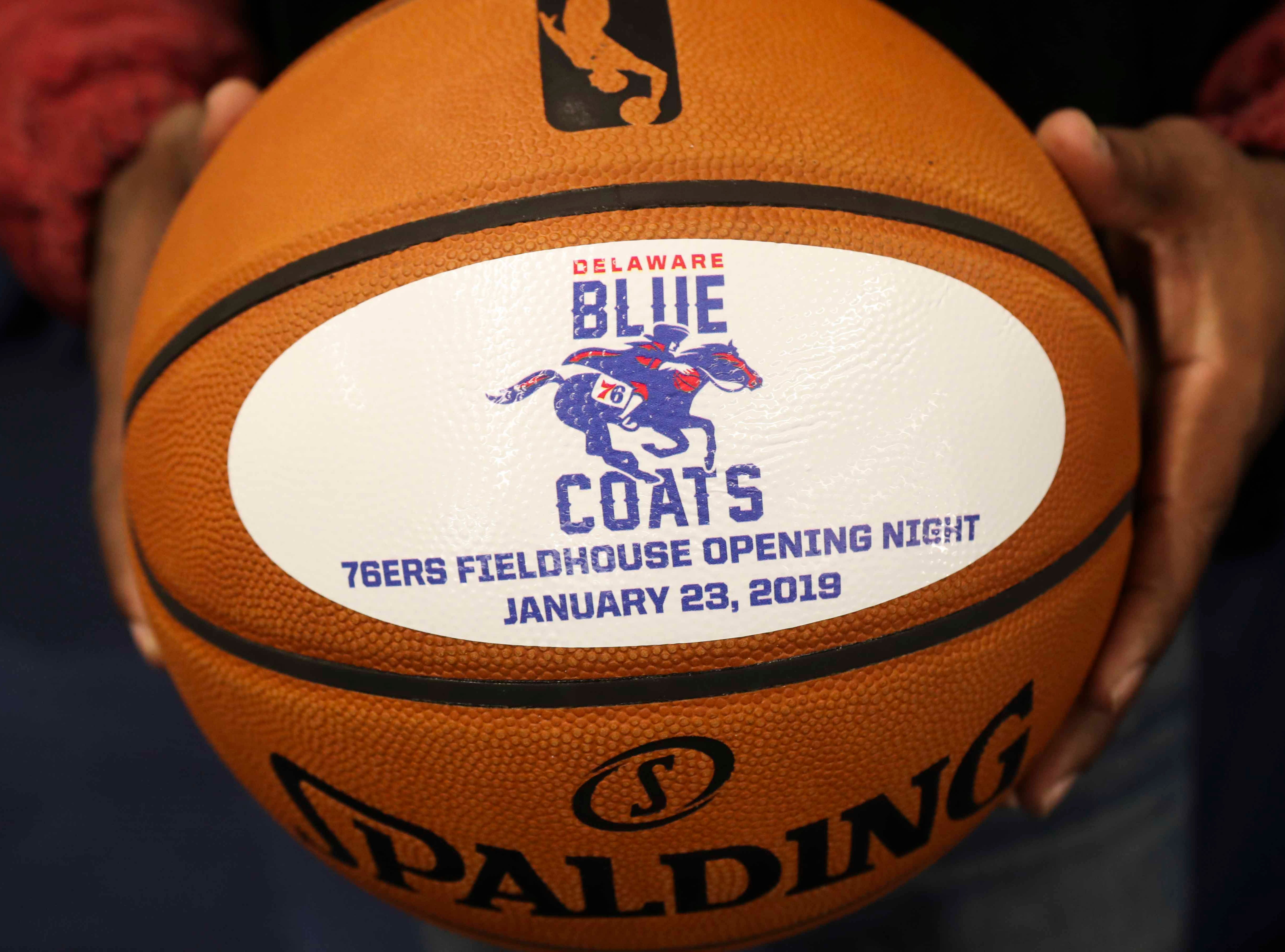 """Stormin'"" Norman Oliver holds a commemorative basketball as the Delaware Blue Coats of the NBA G-League open the 76ers Field House in Wilmington Wednesday."