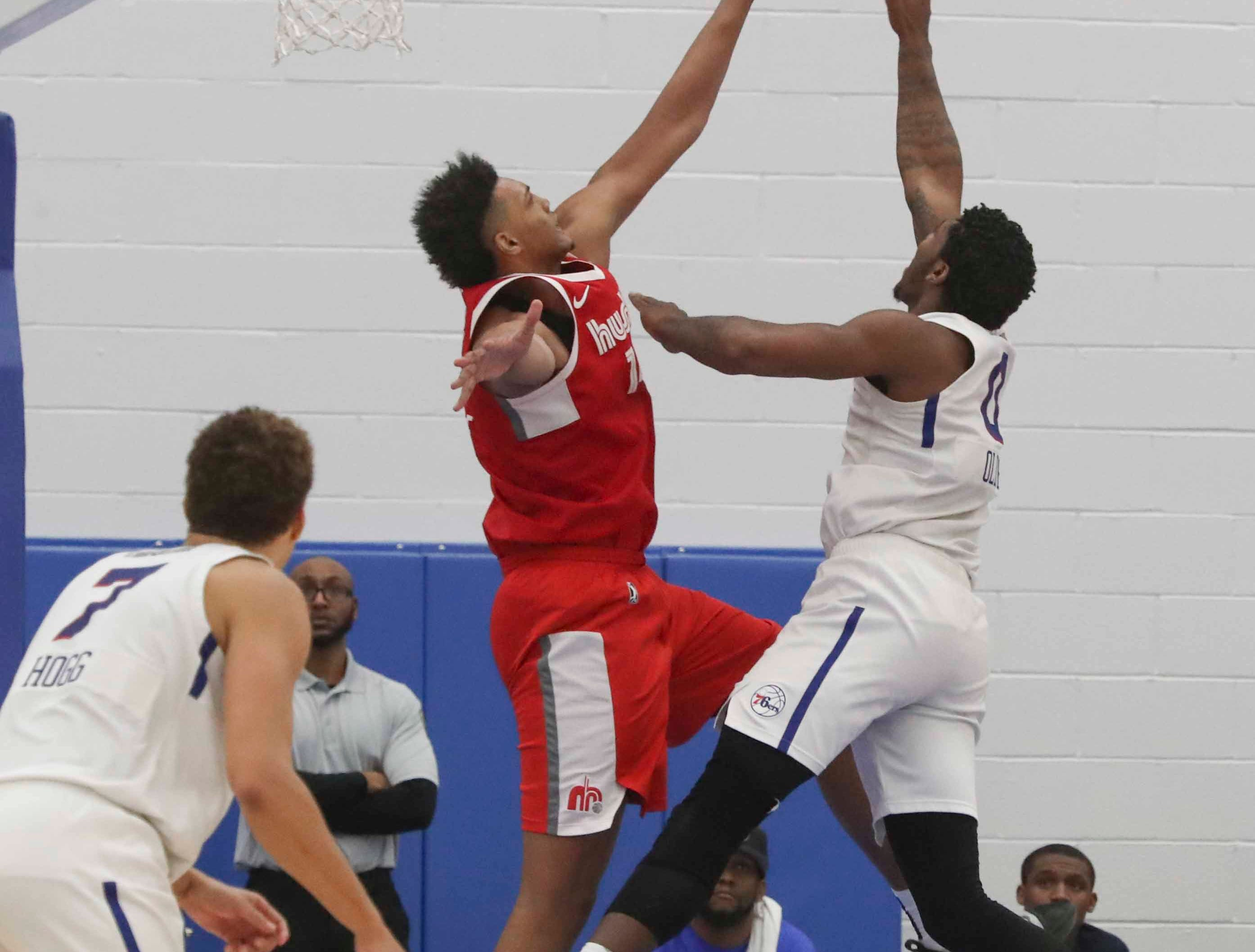 Blue Coats Cameron Oliver (right) gets two points over Memphis' Doral Moore as the Delaware Blue Coats of the NBA G-League open the 76ers Field House in Wilmington Wednesday.