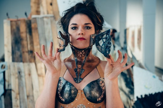 """Delaware College of Art and Design will showcase the ironwork of Ellen Durkan in """"Behind Her Iron Gates"""" (through March 9). The show opens on Feb. 1 with live models wearing the artist's forged fashion."""