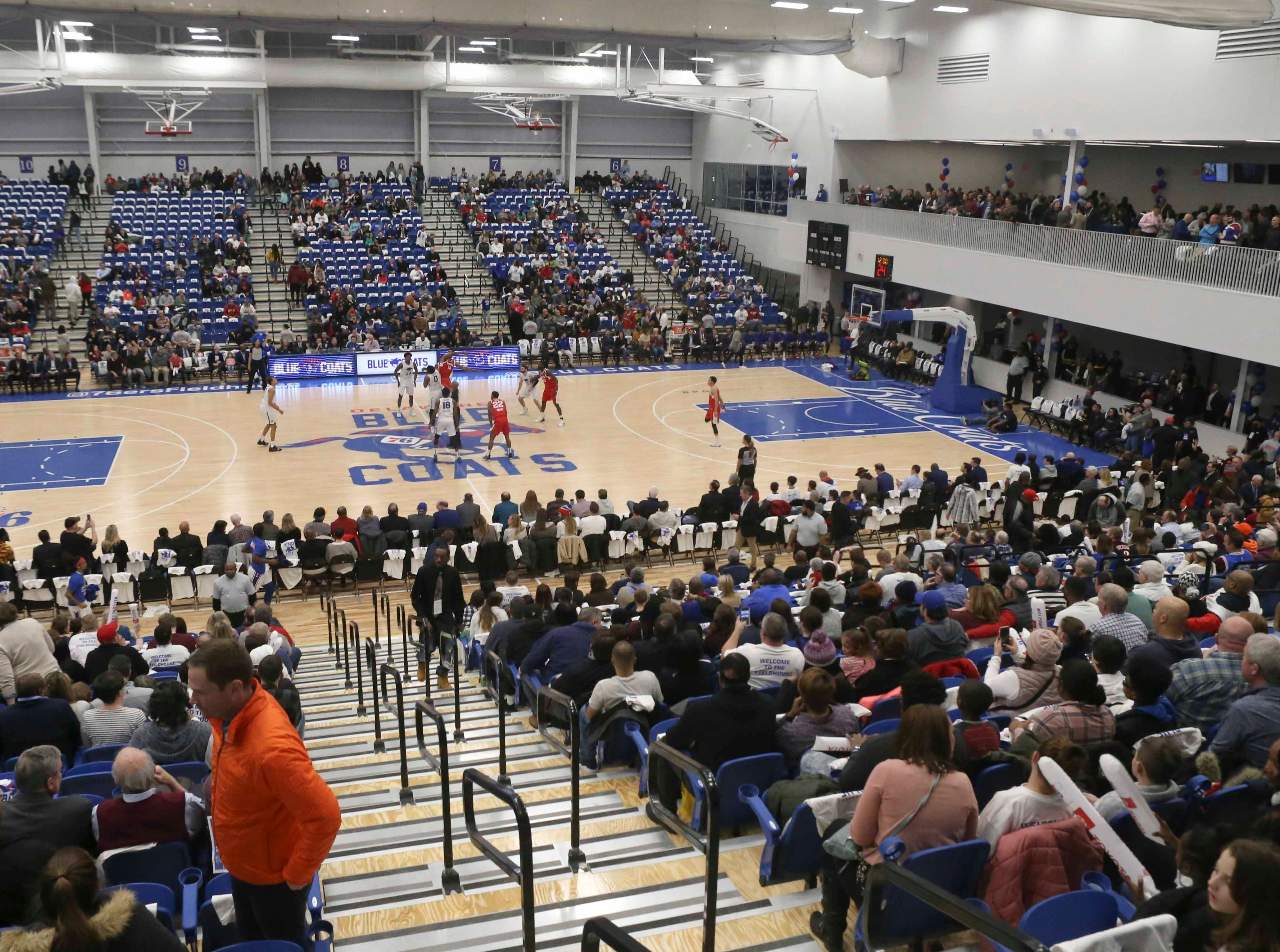 Tipoff finds the crowd still entering the arena as soon-to-be-rectified traffic snarls outside slow things down as the Delaware Blue Coats of the NBA G-League open the 76ers Field House in Wilmington Wednesday.