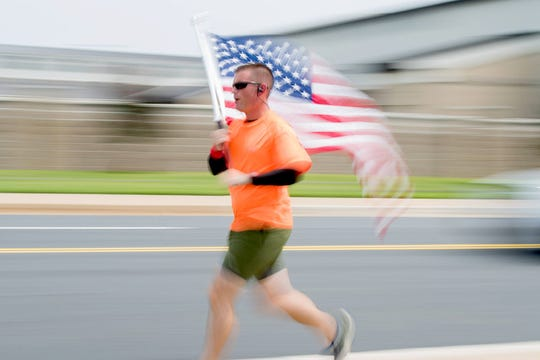 Master Sgt. Trevor Derr, 736th Maintenance Squadron Airframes Powerplant General Section Chief, runs during his lunch break in August 2018 at Dover Air Force Base. Derr was preparing for the 2018 Monster Mash Half Marathon benefiting the Wounded Warrior Project, which he completed in October 2018.