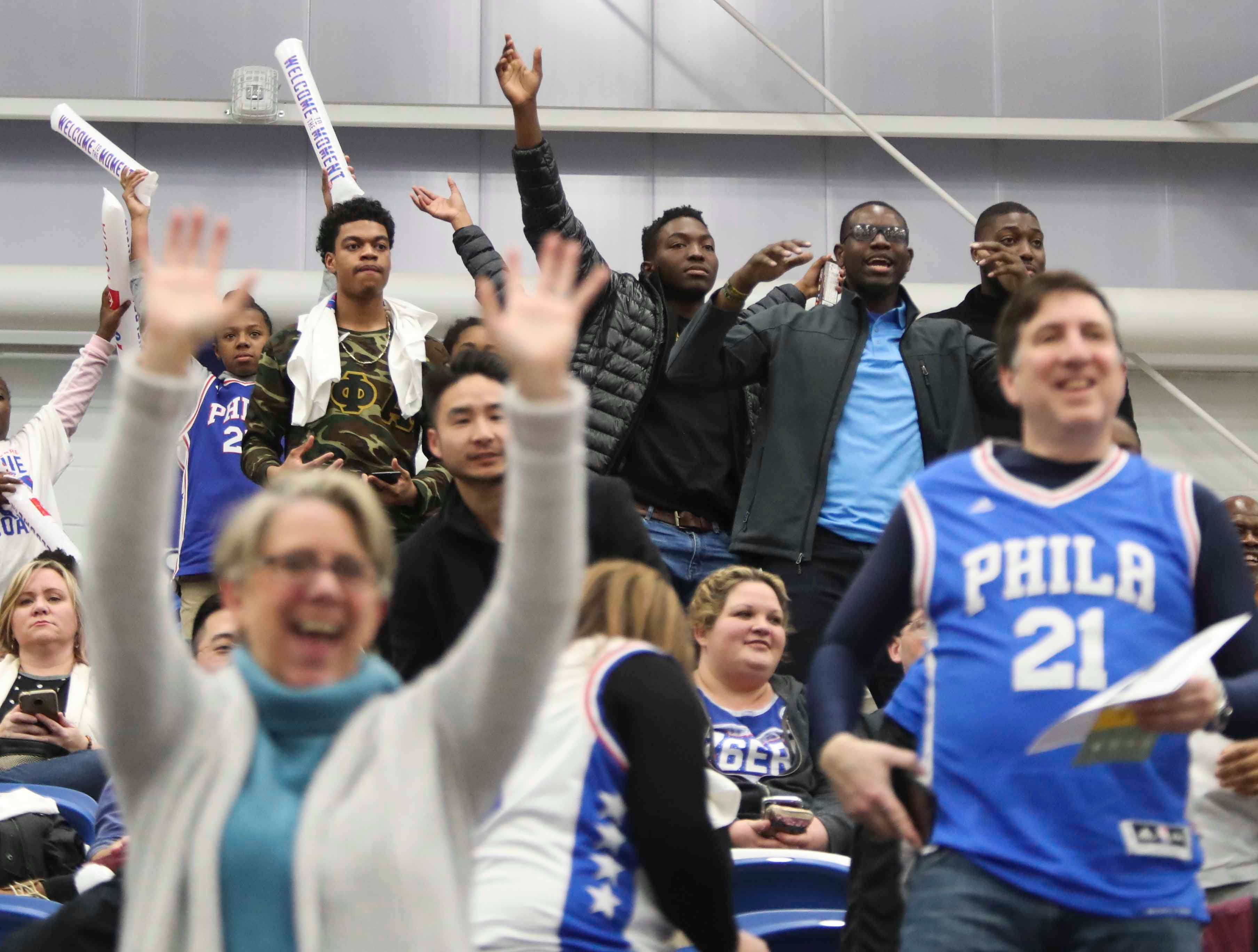 Fans vie for a thrown t-shirts as the Delaware Blue Coats of the NBA G-League open the 76ers Field House in Wilmington Wednesday.