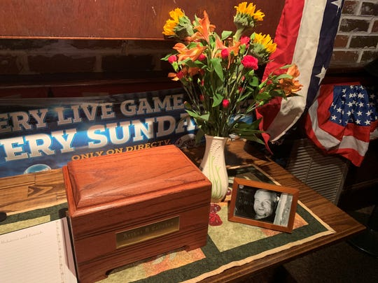 An urn containing the remains of Art Callahan, former owner of The Barn Door in Wilmington, sits in Dead Presidents Pub & Restaurant during a celebration of his life Jan. 16.