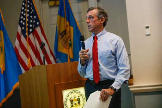 Governor John Carney unveils the proposed budget for fiscal year 2020 during a presentation at the Delaware Public Archives Thursday.