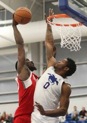 Blue Coat Cameron Oliver (0) can't fend off a dunk by Memphis' Kyle Casey as the Delaware Blue Coats of the NBA G-League open the 76ers Field House in Wilmington Wednesday.
