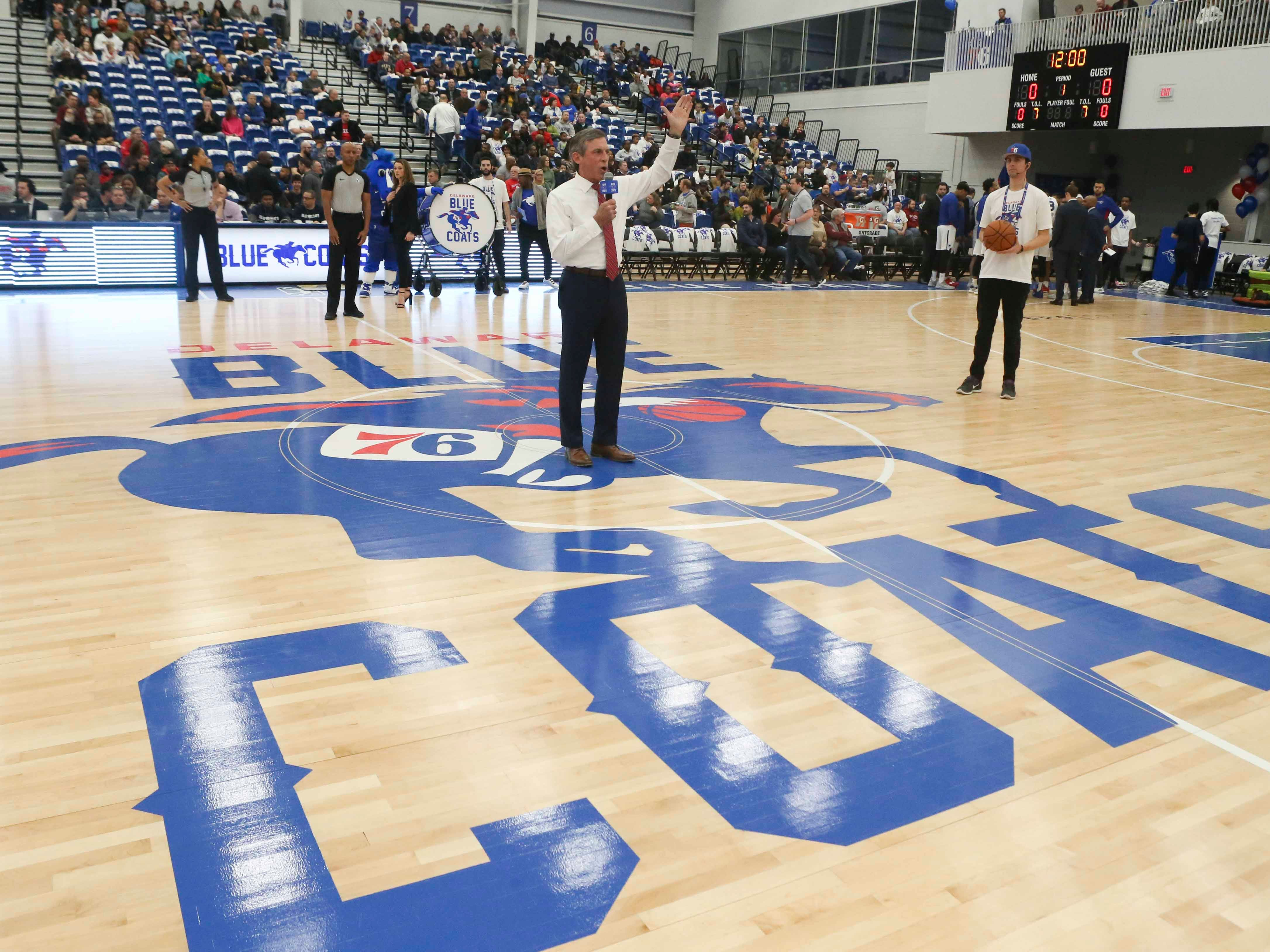 Delaware Governor John Carney helps open the 76ers Field House as the Delaware Blue Coats inaugurate the multi-purpose building in Wilmington Wednesday.