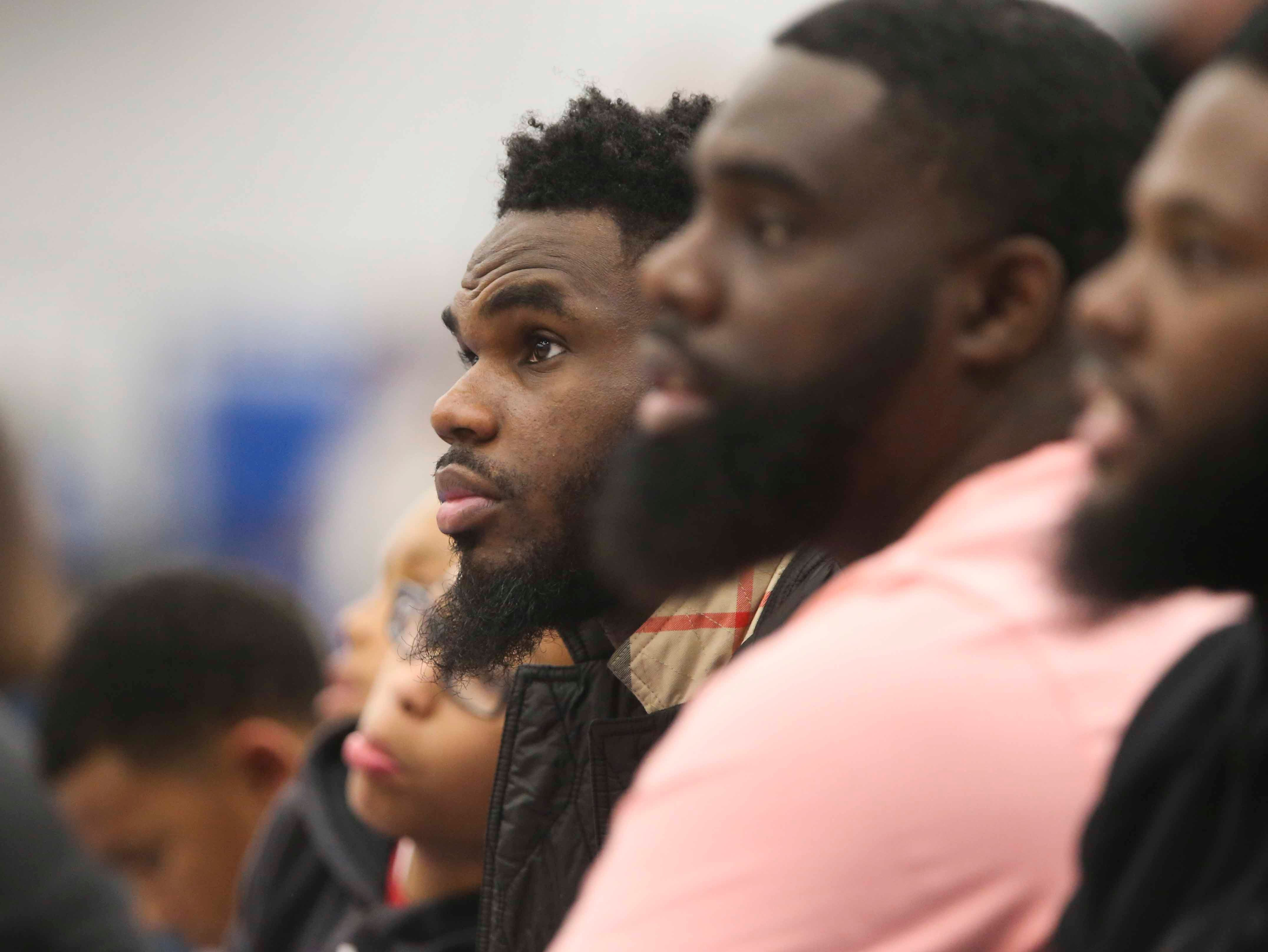 Wendell Smallwood, Wilmington's own Philadelphia Eagle, takes in the second half from the front row as the Delaware Blue Coats of the NBA G-League open the 76ers Field House in Wilmington against the Memphis Hustle Wednesday.