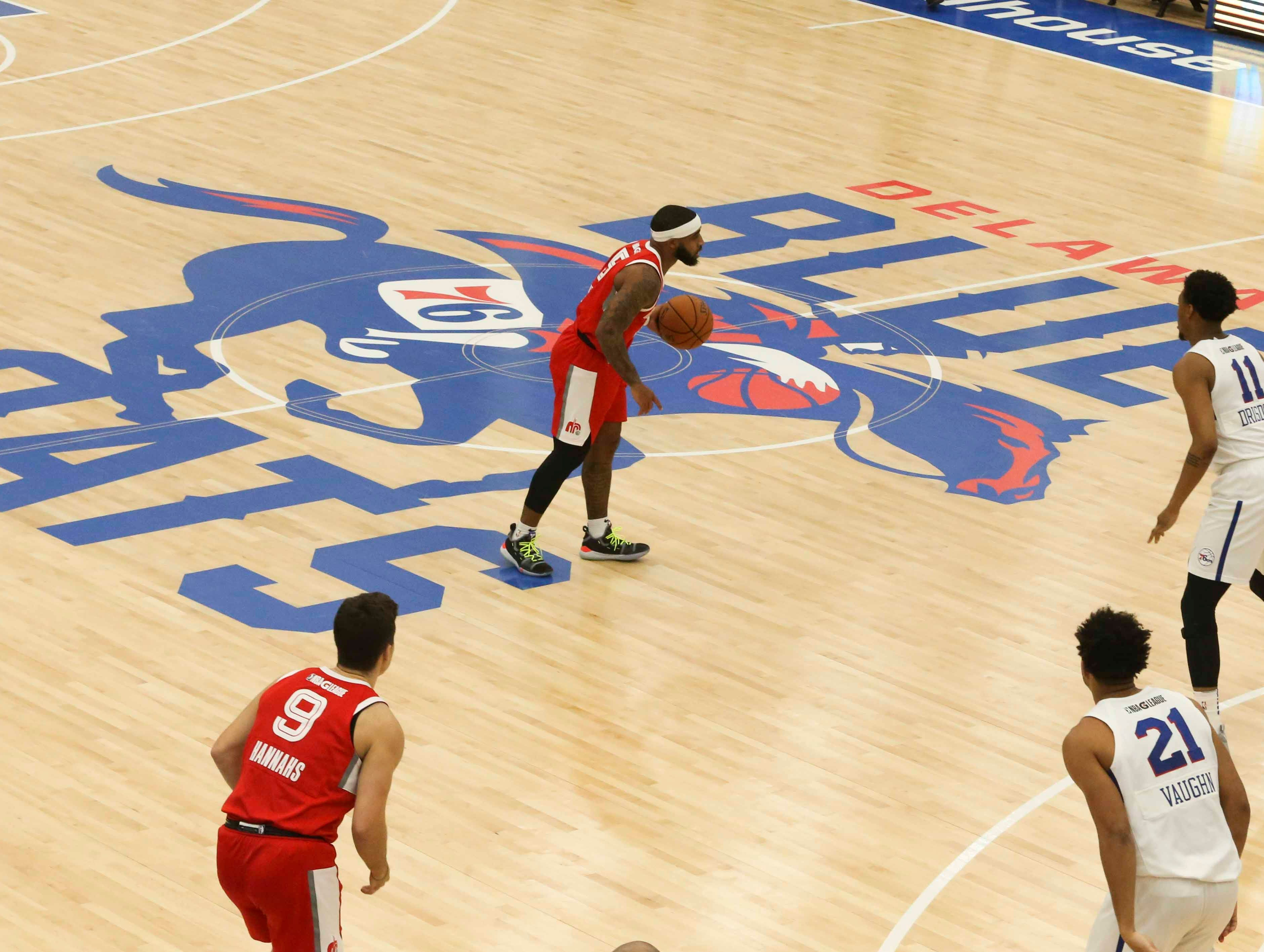 Marcus Keene of the Memphis Hustle brings the ball across the Delaware Blue Coats logo as the NBA G-League opens the 76ers Field House in Wilmington Wednesday.