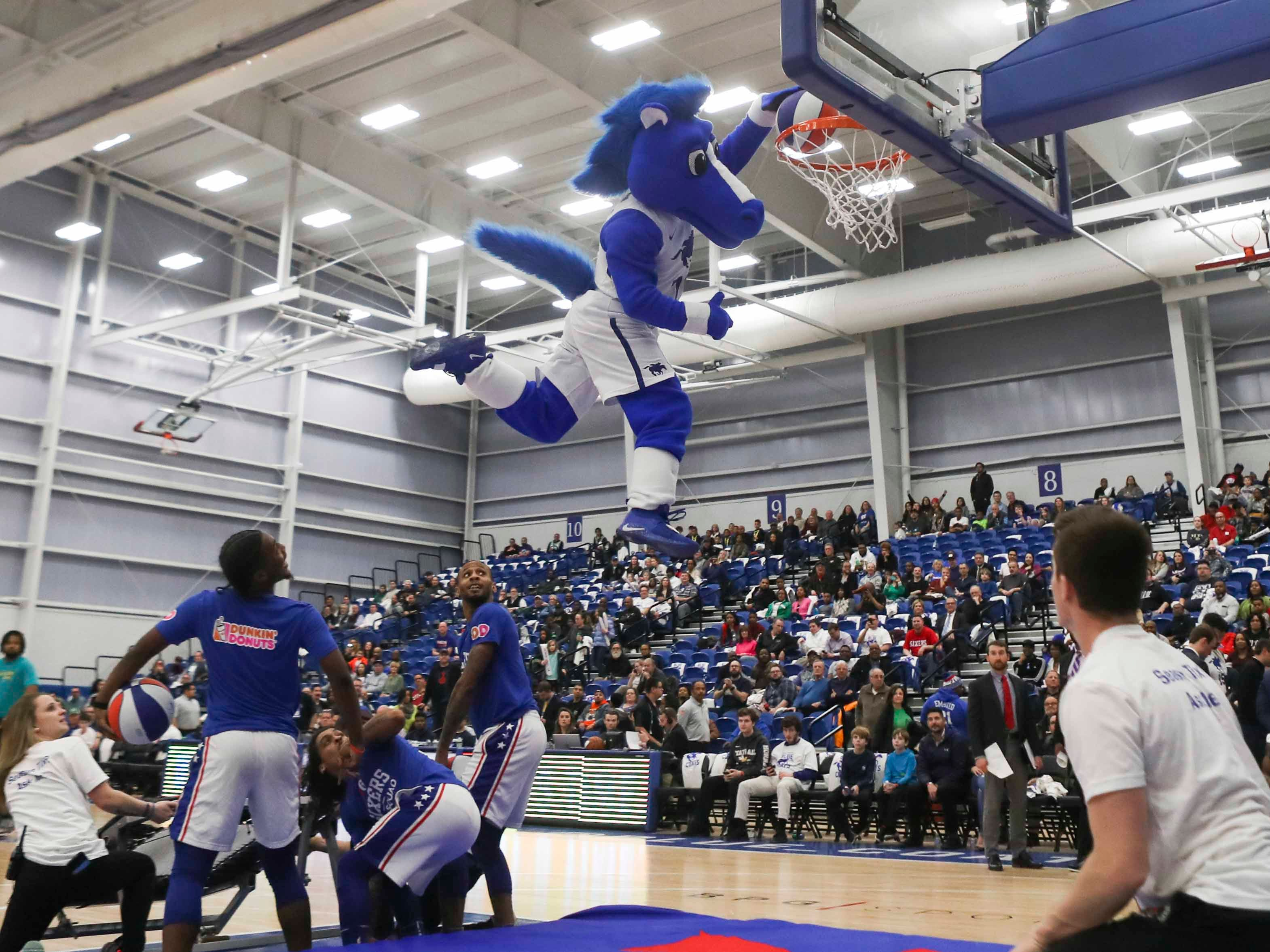 Coaty gets air for a slam as the Delaware Blue Coats of the NBA G-League open the 76ers Field House in Wilmington Wednesday.
