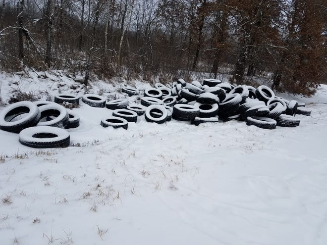 Officials are looking for information on the person or people who dumped between 500 and 1,000 tires near Babcock.