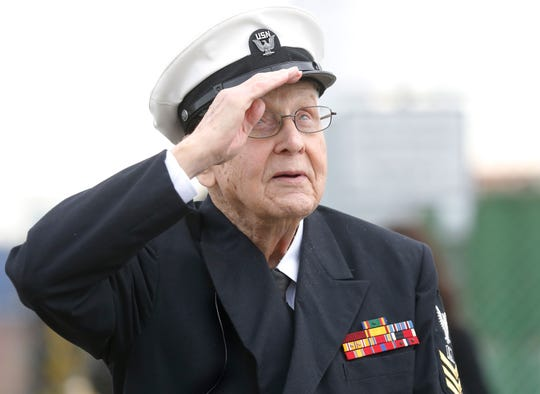 WWII veteran Robert Almquist, 95, from Wisconsin salutes the mast of the ship he served on, the USS Oakland, that stands at Middle Harbor Shoreline Park in Oakland, Calif., on Friday, Jan. 11, 2019. Visit Oakland, a tourist organization, paid for his and his family's flights.
