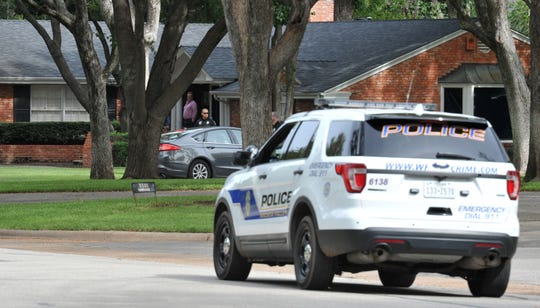 Wichita Falls police execute a search warrant on a residence on Irving Place as part of the investigation into the death of Jason Wilder McDaniel in this Times Record News file photo.