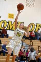 Tri-Valley's Audrey Spiker goes in for two of her game-high 23 points in a 53-48 loss to visiting Maysville on Wednesday night in Dresden.