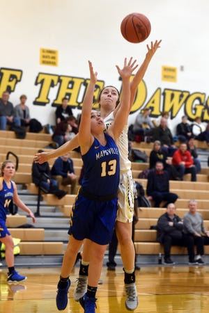 Anna DeVolld, left, fights for a rebound with Tri-Valley's Janie McLoughlin during Maysville's 53-48 win on Wednesday night in Dresden. The Panthers improved to 10-4.