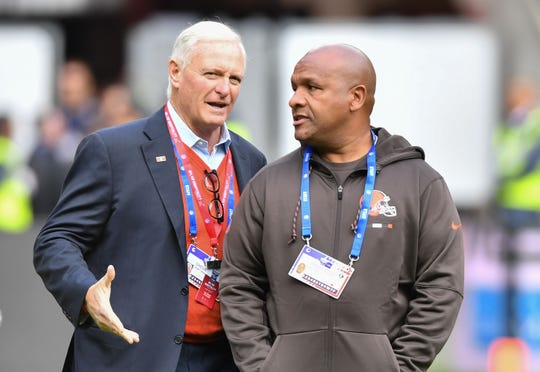 Cleveland Browns owner Jimmy Haslam talks with former head coach Hue Jackson before the 2017 NFL International Series game between the Vikings and Browns.