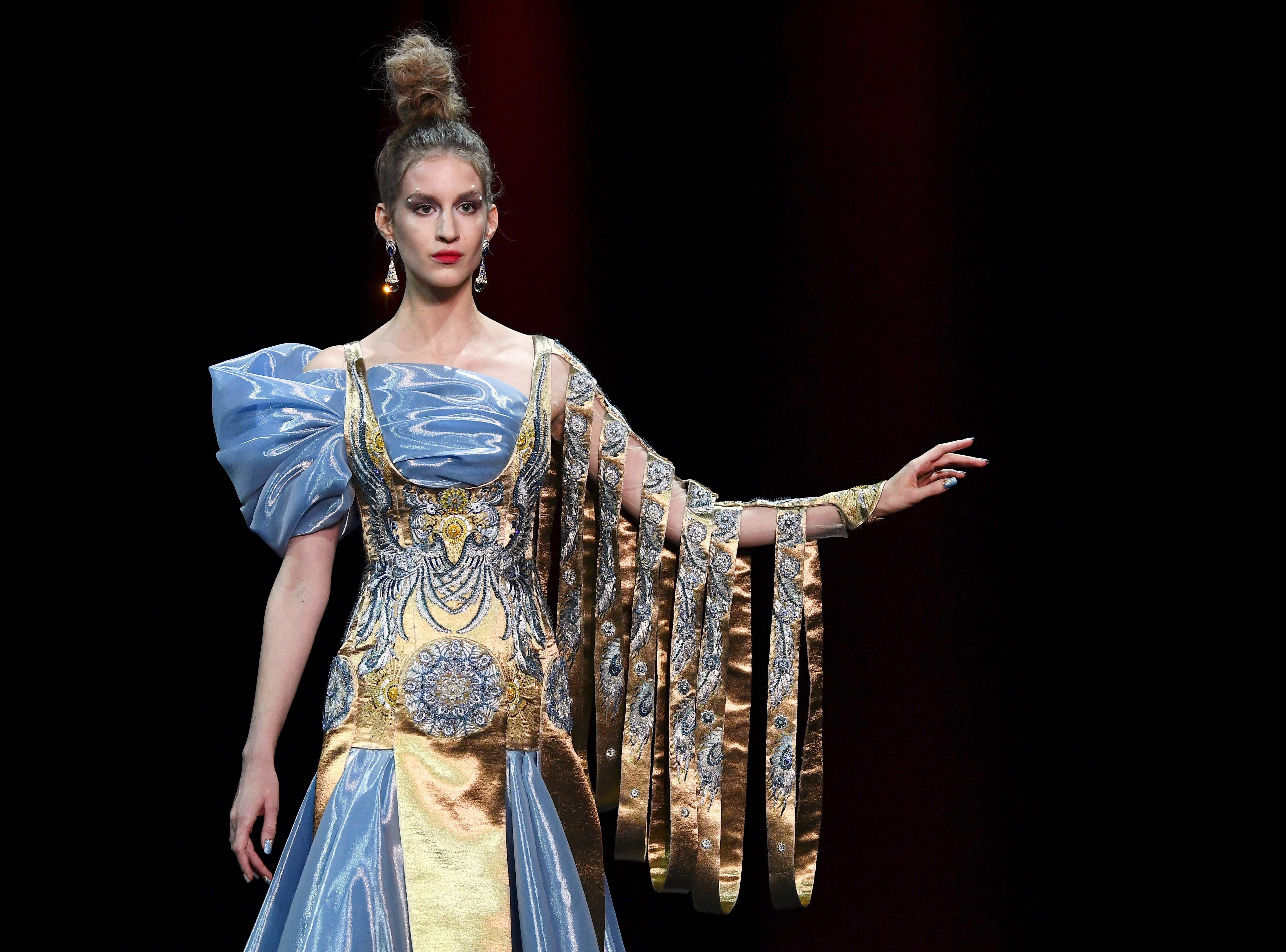A model presents a creation by Guo Pei during the 2019 Spring-Summer Haute Couture collection fashion show in Paris, on January 23, 2019. (Photo by Anne-Christine POUJOULAT / AFP)ANNE-CHRISTINE POUJOULAT/AFP/Getty Images ORIG FILE ID: AFP_1CK48X