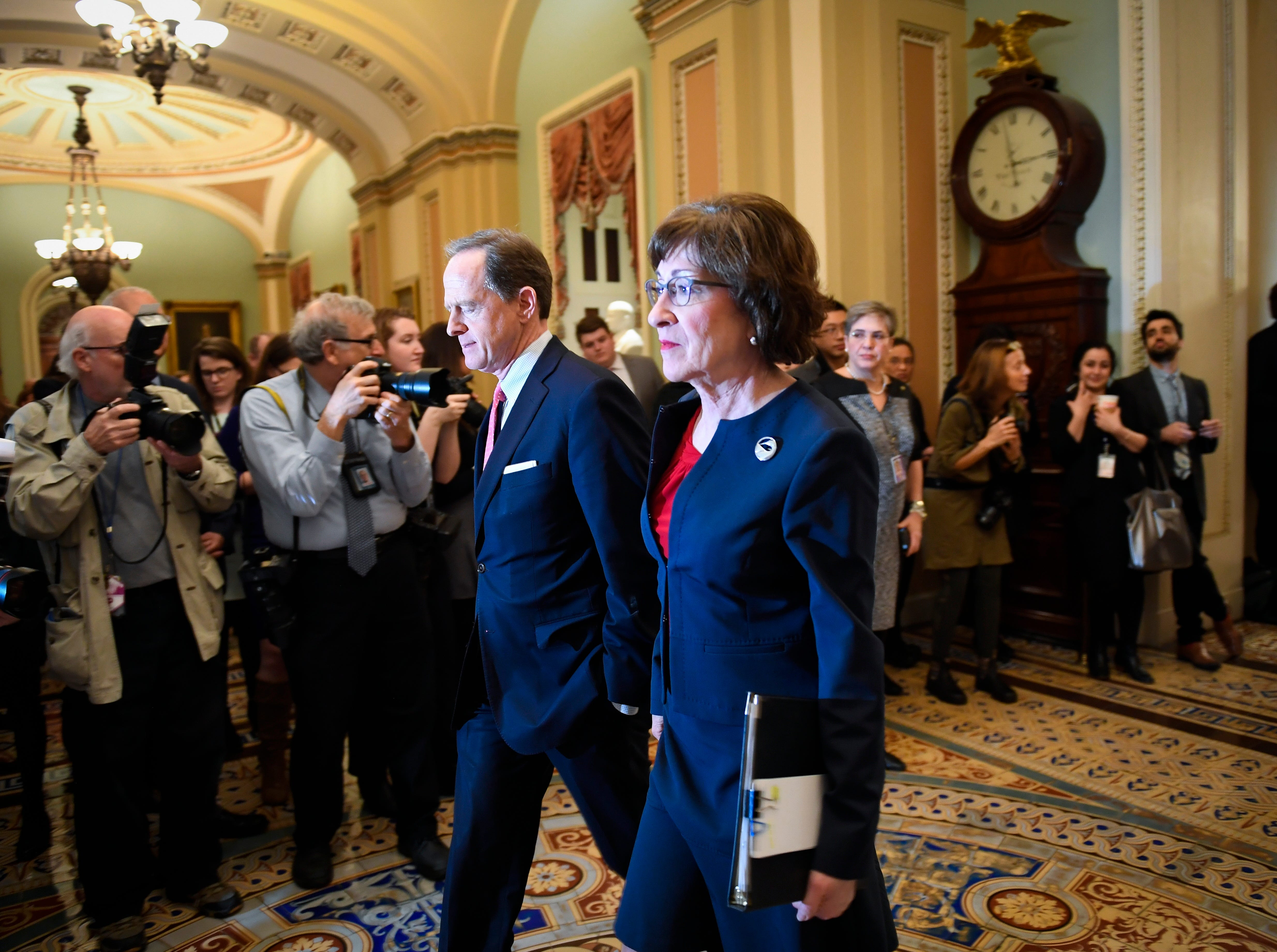 Senator Susan Collins (R-ME) and Senator Pat Toomey (R-PA) walking into the Senate Chambers before the Senate voted to reject a pair of dueling bills Thursday to fund the federal government and end the longest partial government shutdown in history.