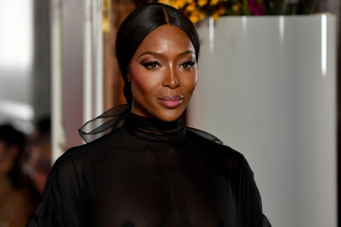 25fc55a31c Naomi Campbell flashes nipples in sheer Valentino gown on Paris runway