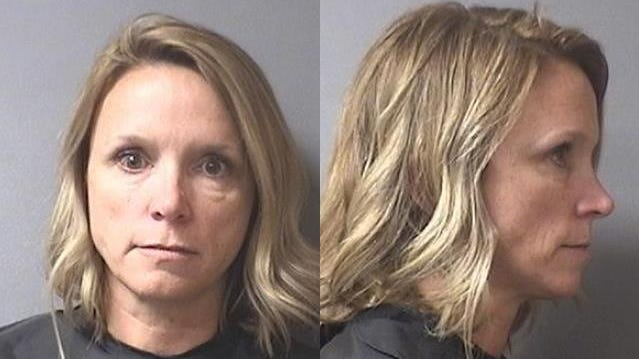 A Madison County, Indiana sheriff's department mugshot of Casey Smitherman, superintendent of Elwood Community Schools who allegedly used her insurance to help a sick student receive treatment.