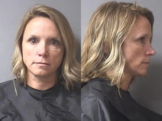 A Madison County, Indiana sheriff's department mugshot of Casey Smitherman, superintendent of Elwood Community Schools who allegedly used her insurance to help a sick student receive treatment. January 2019.