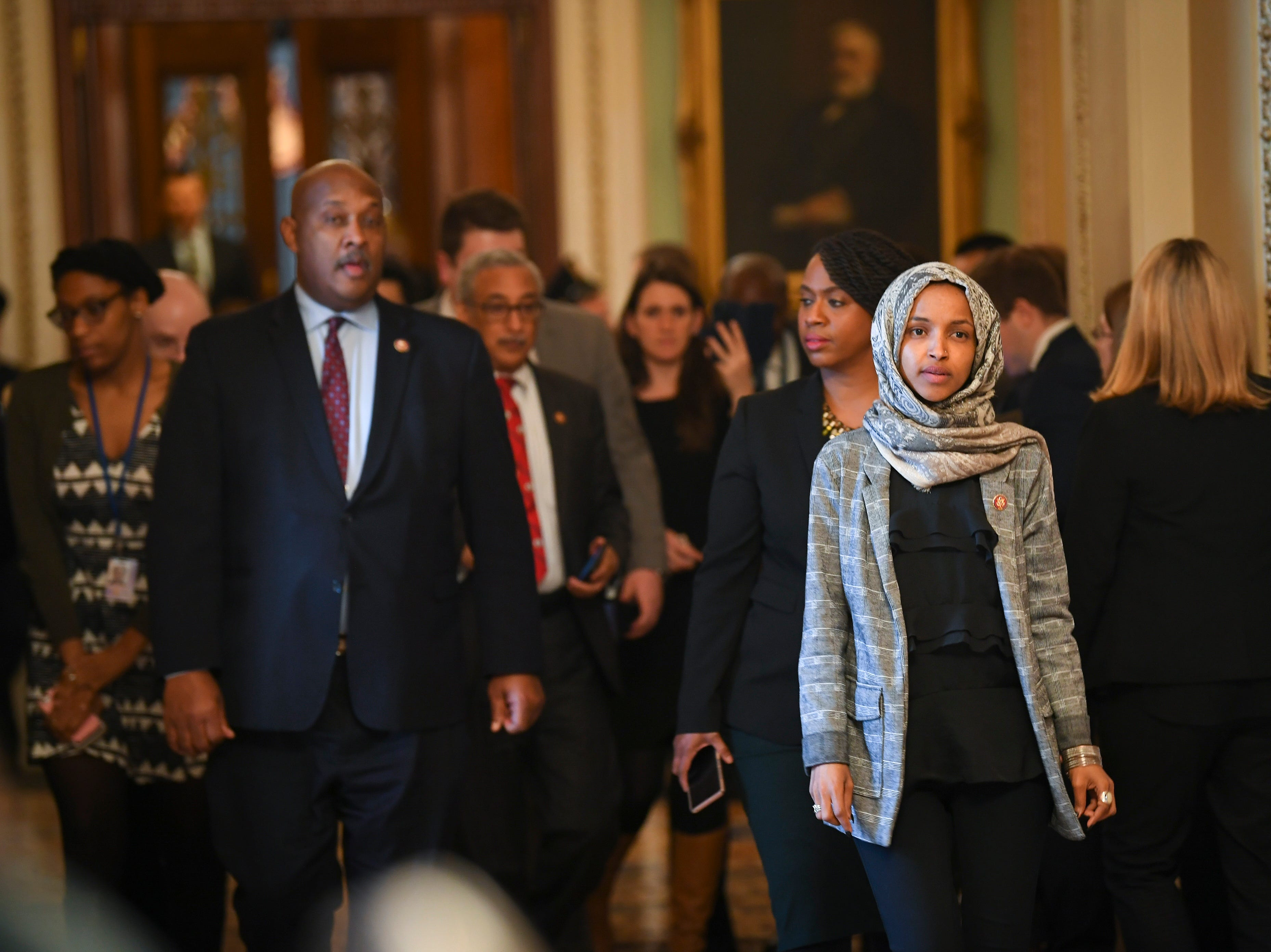 Rep. Ilhan Omar (D-MN) and other House Democrat members walking from the Senate Chambers after the Senate voted to reject a pair of dueling bills Thursday to fund the federal government and end the longest partial government shutdown in history.