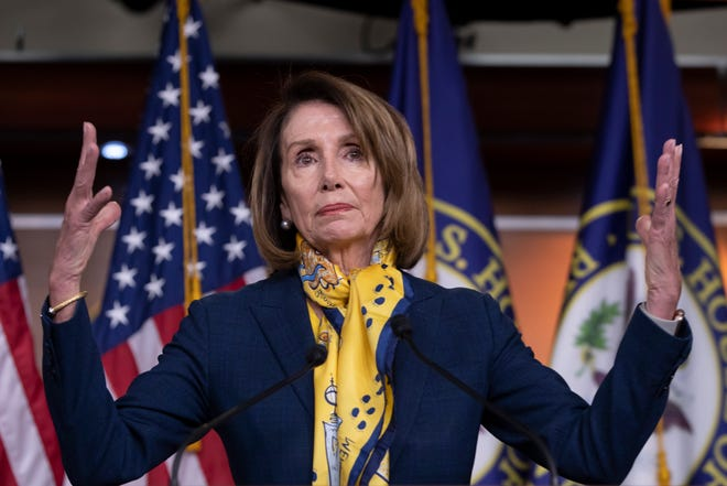 Speaker of the House Nancy Pelosi talks to reporters at the Capitol in Washington Jan. 24, a day after officially postponing President Donald Trump's State of the Union address until the government is fully reopened.