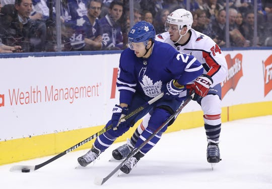 Maple Leafs right wing William Nylander (29) skates with the puck as Capitals defenseman John Carlson (74) defends in the second period at Scotiabank Arena on Wednesday.