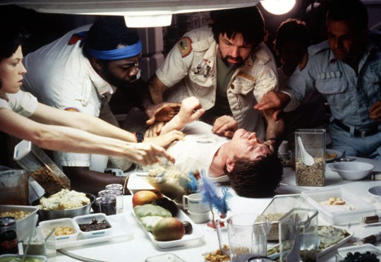 "Kane (John Hurt, on table) comes to a horrific end as Ripley (Sigourney Weaver), Parker (Yaphet Kotto), Dallas (Tom Skerritt) and Ash (Ian Holm) try to help in the 1979 sci-fi thriller ""Alien."""