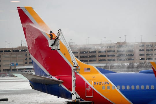 Workers de-ice a Southwest aircraft at Chicago's Midway Airport on Jan. 22, 2019.