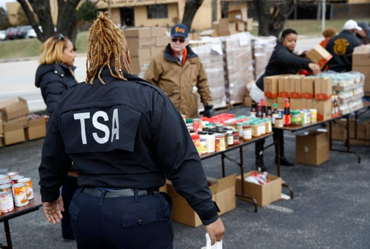 A TSA employee visits a food pantry for furloughed government workers on Jan. 23, 2019, in Baltimore.