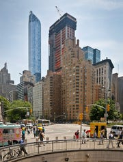 A crane sits atop a new condominium skyscraper at 220 Central Park South in New York in 2016. Ken Griffin, the billionaire founder of the Citadel hedge fund, has purchased a penthouse in the building for about $238 million, The Wall Street Journal reported Wednesday — the highest-priced home ever sold in the U.S.