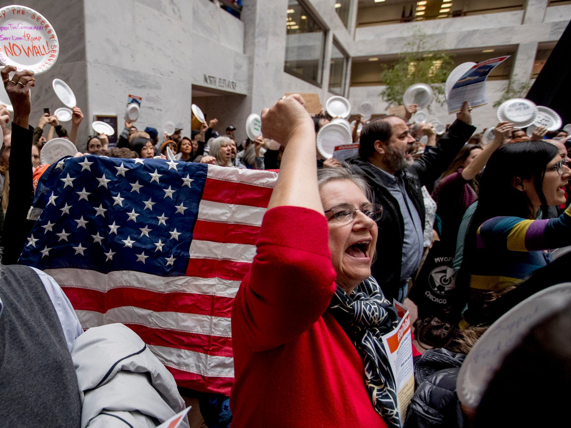 Furloughed government workers affected by the shutdown yell during a protest against the ongoing partial government shutdown on Capitol Hill in Washington, Jan. 23, 2019.