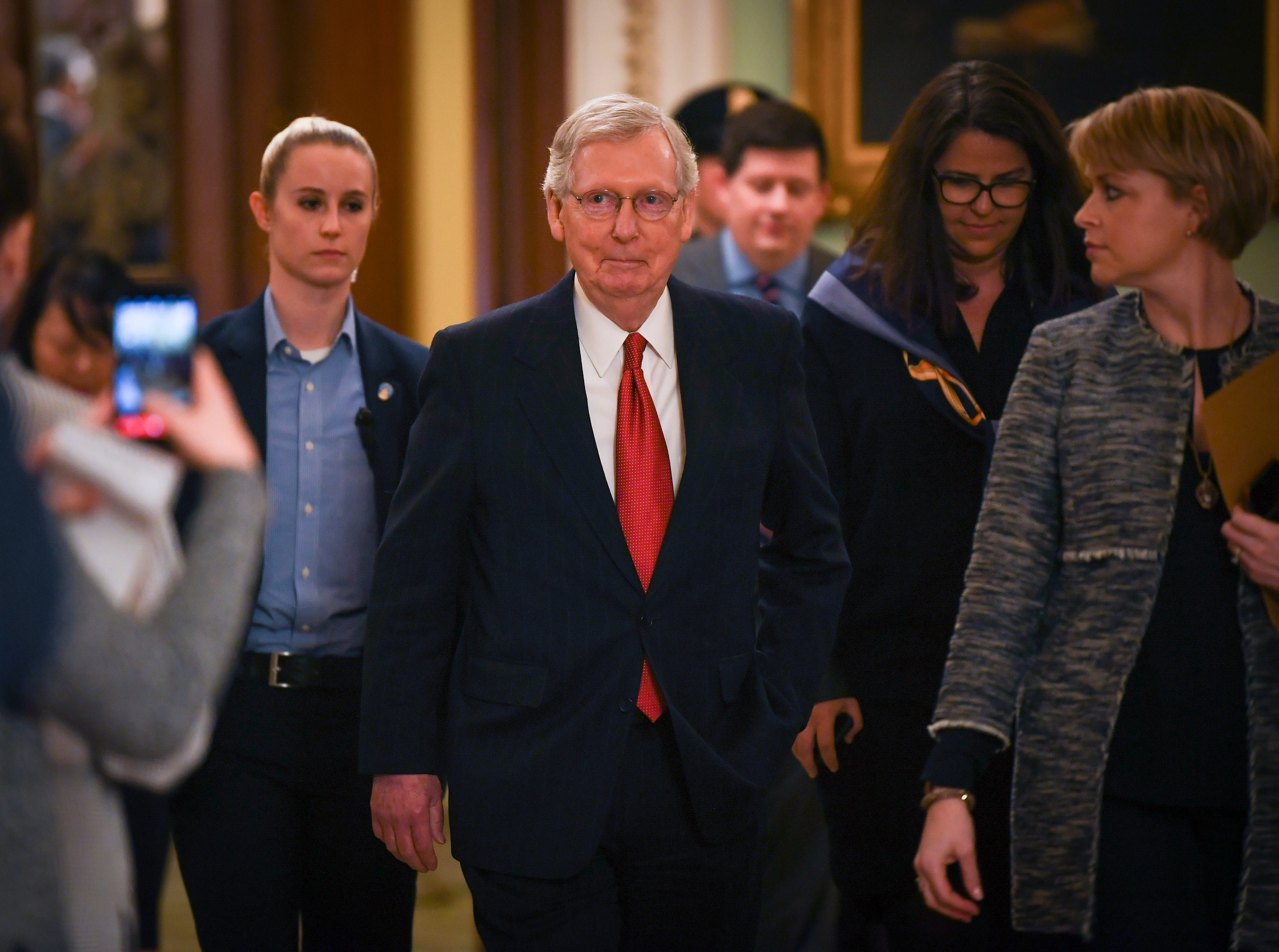 Senate Majority Leader Mitch McConnell (R-KY) departs the Senate Chamber.