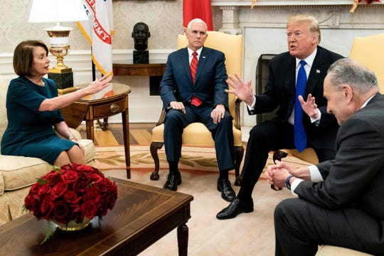 In this file photo taken on December 11, 2018, Vice President Mike Pence listens while Democratic incoming House Speaker Nancy Pelosi, President Donald Trump  and Democratic Senate Minority Leader Chuck Schumer argue about the impending government shutdown during a meeting at the White House in Washington, D.C.